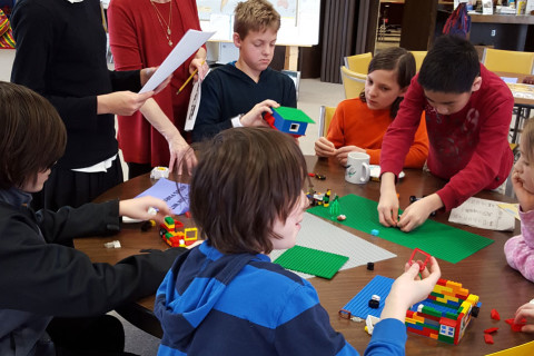 Children playing legos at First Presbyterian Church in Iowa City